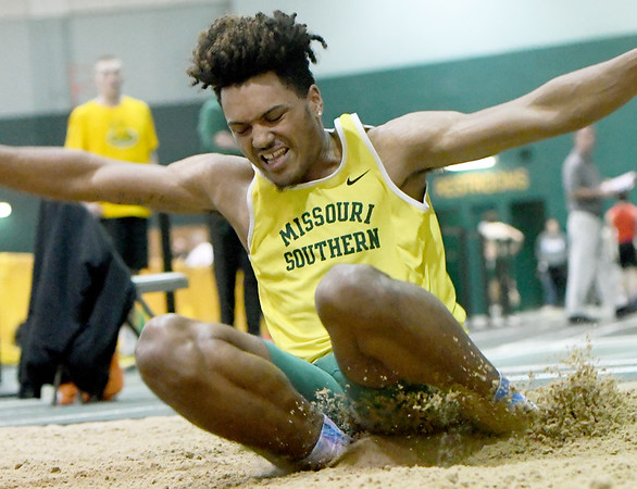Missouri Southern's Josh Norville competes in the men's long jump on Friday at Leggett & Platt.<br /> Globe | Laurie Sisk