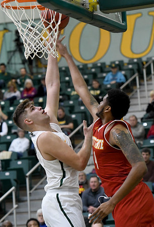 Missouri Southern's Enis Memic scores over the outstretched arms of Pittsburg State's Deitrich Cole, Jr. during their game on Tuesday night at Leggett & Platt.<br /> Globe | Laurie SIsk