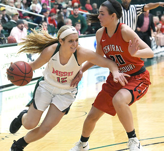 Missouri Southern's Chelsey Henry (15) fights to get past Central Missouri's Megan Skaggs (20) during their game on Saturday at Leggett & Platt. Globe   Laurie SIsk