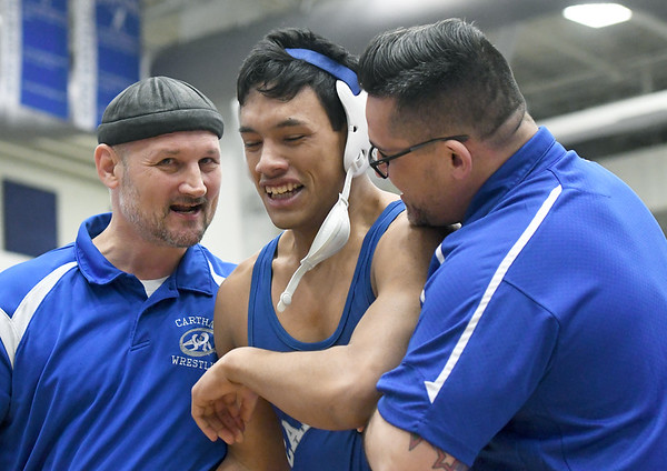 Carthage coaches Kenny Brown, left and Don Petticrew hug Ymbar Polanco after gis 172-lb. semifinal win at the Clas s3, District 3 tournament on Saturday at Carthage High School.<br /> Globe | Laurie Sisk