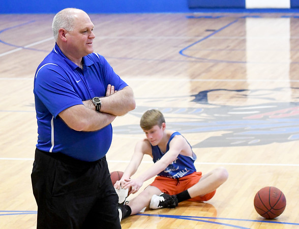 McAuley basketball coach Randy Robertson leads his players through warm-ups before practice on Wednesday at McAuley.<br /> Globe   Laurie Sisk