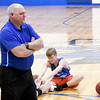 McAuley basketball coach Randy Robertson leads his players through warm-ups before practice on Wednesday at McAuley.<br /> Globe | Laurie Sisk