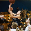 Galena's Paige Jensen drives in for a basket against Riverton during Tuesday's game in Riverton.<br /> Globe | Roger Nomer