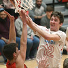 Webb City's Tanner Rogers (12) puts up a shot as Nixa's Jack Sanders (23) defends during their game on Friday night at the Cardinal Dome.<br /> Globe | Laurie Sisk
