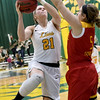 Missouri Southern's Desirea Buerge (21) scores over the outstretched arms of Pittsburg State's Elena Flott (5) during their game on Tuesday night at Leggett & Platt.<br /> Globe | Laurie SIsk
