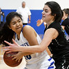 McAuley's Johanna Damaso, left, tries to get past the defense of College Heights' Lainey Lett during their game on Thursday night at McAuley.<br /> Globe | Laurie Sisk