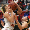 Missouri Southern's Chelsey Henry, right, takes the charge on Pittsburg State's Madison Northcutt  during their game on Saturday at John Lance Arena.<br /> Globe | Laurie Sisk