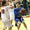 Colgan's Jeremiah Buche (11) tries to get past the double team of Baxter Springs' Brant Trease (20) and Preston Landis (22) during their game on Friday night at Baxter Springs.<br /> Globe | Laurie Sisk