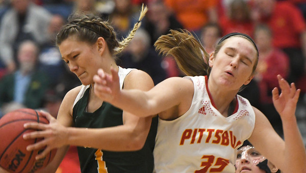 Missouri Southern's Dru Clark (1) land Pittsburg State's Megan Maher (35) battle for the ball during their game on Saturday at John Lance Arena.<br /> Globe | Laurie Sisk