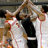 Missouri Southern's Koray Gilbert, center, battles Pittsburg State's Donovan Franklin (3) and Dietrich Cole for a rebound during their game on Saturday at John Lance Arena.<br /> Globe | Laurie Sisk