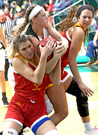 From the left: Pittsburg State's Madison Northcutt and Missouri Southern's Desirea Buerge battle for a loose ball during their game on Tuesday night at Leggett & Platt. Globe | Laurie SIsk