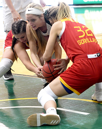 Pittsburg State's Brenlee McPherson, left and Madison Northcutt, right,  battle Missouri Southern's Chelsey Henry for a loose ball during their game on Tuesday night at Leggett & Platt. Globe | Laurie SIsk