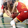 Pittsburg State's Brenlee McPherson, left and Madison Northcutt, right,  battle Missouri Southern's Chelsey Henry for a loose ball during their game on Tuesday night at Leggett & Platt.<br /> Globe | Laurie SIsk