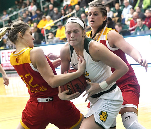 Missouri Southern's Desirea Buerge, center battles Pittsburg State's Madison Northcutt (32) and Brenlee McPherson, right, during their game on Tuesday night at Leggett & Platt.<br /> Globe | Laurie SIsk