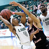 Missouri Southern's CJ Carr (0) plays keep away from  Central Missouri's Clarence Smith (4) during their game on Saturday at Leggett & Platt.<br /> Globe | Laurie SIsk