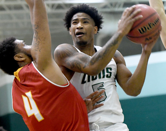 Missouri Southern's Braelon Walker (5) tries to score as Pittsburg State's Deitrich Cole, Jr. (4) defends during their game on Tuesday night at Leggett & Platt.<br /> Globe | Laurie SIsk