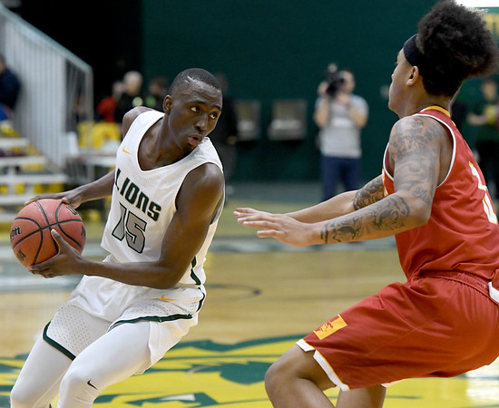 Missouri Southern's Elyjah Clark (15) looks to get past Pittsburg State's Donovan Franklin (3) during their game on Tuesday night at Leggett & Platt. Globe | Laurie SIsk