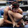 Webb City's Josh Copher, top, takes control of Willard's Michael Finley during their 120-lb.match on Friday at the Class3, District 3 tournament at Carthage High School.<br /> Globe | Laurie Sisk