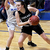 College Heights' Marlee Lett (14) works to get past McAuley's Becca Freitas (40) during their game on Thursday night at McAuley.<br /> Globe | Laurie Sisk