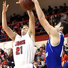 Baxter Springs' Blake Thiessen (21) and Colgan's Whit Dungan (10) battle for a rebound during their game on Friday night at Baxter Springs.<br /> Globe | Laurie Sisk