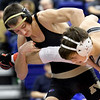 Neosho's Trenton Young, left, works to takedown Willard's Ryder Heimbach during their 132-lb. match on Friday at the Class3, District 3 tournament at Carthage High School.<br /> Globe | Laurie Sisk
