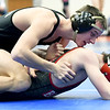 Neosho's Trenton Young, top, battles Carl Junction's Holden Hughes during their 132-lb. semifinal match at the Class3, District 3 tournament on Saturday at Carthage High School.<br /> Globe | Laurie Sisk