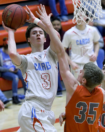Webb City's Grant Ellis (3) puts up a shot as Nixa's Max Bilbrey (35) defends during their game on Friday night at the Cardinal Dome.<br /> Globe | Laurie Sisk