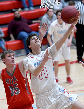 Webb City's Alex Pickett (11) gets past Nixa's Max Bilbrey (35) during their game on Friday night at the Cardinal Dome.<br /> Globe | Laurie Sisk