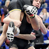 Neosho's Braxton Barnes prepares to take down Camdenton's Gabe Blain during their 138-lb. semifinal match at the Class3, District 3 tournament on Saturday at Carthage High School.<br /> Globe | Laurie Sisk