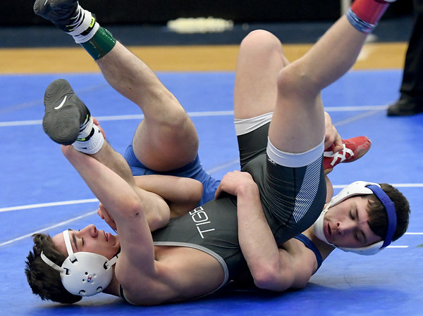 Carthage's Nick Norbury, right, battles Willard's Oscar Martinez during their 126-lb. match on Friday at the Class3, District 3 tournament at Carthage High School.<br /> Globe | Laurie Sisk