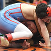 Webb City's Kyler Carter, left and McDonald County's Christian Davidson battle during their 106-lb match on Friday at the Class3, District 3 tournament at Carthage High School.<br /> Globe | Laurie Sisk