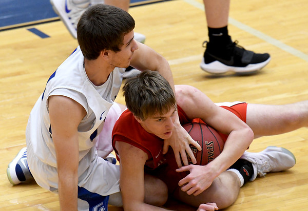 From the left: Carthage's Brett Fullerton and Carl Junction's Teagan Armentrout scramble for a loose ball during their game on Tuesday night at Carthage.<br /> Globe   Laurie Sisk