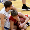 From the left: Carthage's Brett Fullerton and Carl Junction's Teagan Armentrout scramble for a loose ball during their game on Tuesday night at Carthage.<br /> Globe | Laurie Sisk