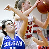 Baxter Springs Delaney Barnes (24) snags the rebound from Colgan's Kate Radell (11) during their game on Friday night at Baxter Springs.<br /> Globe | Laurie Sisk
