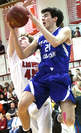 Colgan's Aaron Higginbotham (23) tries to score as Baxter Springs' Max Sheffer (45) defends during their game on Friday night at Baxter Springs.<br /> Globe | Laurie Sisk