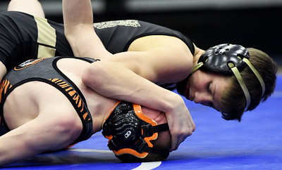 Neosho's Cayden Auch (top) works toward a first period pin of Republic's Wyatt George during their 106-lb. match on Friday at the Class3, District 3 tournament at Carthage High School. Globe   Laurie Sisk