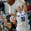 College Heights' Claire Lowry (31) gets past College Heights' Taylor Ross for a score during their game on Thursday night at McAuley.<br /> Globe | Laurie Sisk