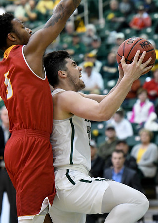 Missouri Southern's Vince Fritz (25) drives to the basket as Pittsburg State's Demetrius Levarity (5) defends during their game on Tuesday night at Leggett & Platt. Globe | Laurie SIsk