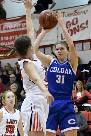 Colgan's Cathy Farmer (31) lines up a shot as Baxter Springs' Kassity Shafer (14) defends during their game on Friday night at Baxter Springs.<br /> Globe | Laurie Sisk