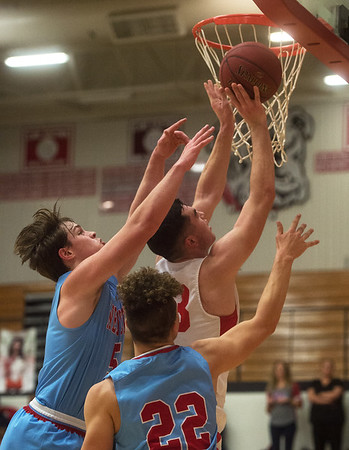 Carl Junction's Alex Baker drives around Webb City's Alex Gaskill (5) and Jaystin Smith (22) during Tuesday's game in Carl Junction.<br /> Globe | Roger Nomer