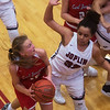 Carl Junction's Shila Winder gets around Joplin's Dayleigh Smith for a basket during Friday's game at Joplin. <br /> Globe | Roger Nomer