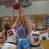 Webb City's Abby Brownfield pulls down a rebound between Carl Junction's Shila Winder (12) and Taylor Hughes (14) during Tuesday's game in Carl Junction.<br /> Globe | Roger Nomer