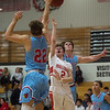Webb City's Jaystin Smith (22) blocks a shot from Carl Junction's Isaac Hoberecht as Webb City's Alex Gaskill (5) also defends during Tuesday's game in Carl Junction.<br /> Globe | Roger Nomer