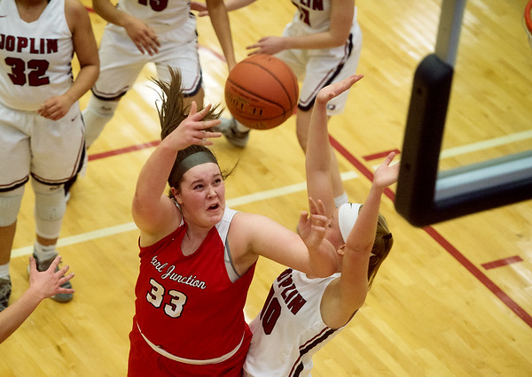 Carl Junction's Katie Scott puts up a shot over Joplin's Grace Ipsen during Friday's game at Joplin. <br /> Globe | Roger Nomer
