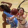 Carl Junction's Jessa Hylton reaches for a loose ball around Webb City's Keira Jackson during Tuesday's game in Carl Junction.<br /> Globe | Roger Nomer