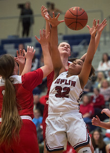 Joplin's Dayleigh Smith fights for a rebound against Carl Junction's Hannah Lee during Friday's game at Joplin.  Globe | Roger Nomer