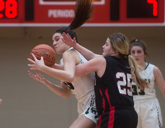 College Heights' Lainey Lett takes the ball away from Southwest's Ashley Sharp during Monday's game in Webb City.<br /> Globe | Roger Nomer