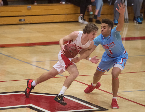 Carl Junction's Teagan Armentrout drives against Webb City's Terrell Kabala during Tuesday's game in Carl Junction.<br /> Globe | Roger Nomer