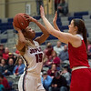 Joplin's Maila Mack puts up a shot over Carl Junction's Hannah Lee during Friday's game at Joplin. <br /> Globe | Roger Nomer