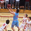 Webb City's Alex Gaskill drives around Carl Junction defenders Nakoa Warren (15), Teagan Armentrout (14) and Isaac Hoberecht (2) during Tuesday's game in Carl Junction.<br /> Globe | Roger Nomer